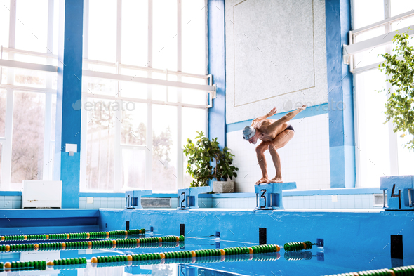 Senior man ready to jump in the swimming pool. - Stock Photo - Images