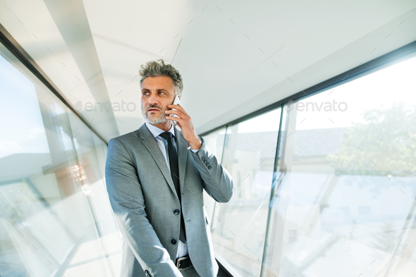 Mature businessman with smartphone travelling. - Stock Photo - Images
