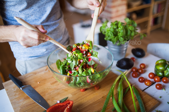 Unrecognizable man cooking. - Stock Photo - Images