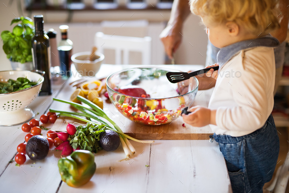 Young father with a toddler boy cooking. - Stock Photo - Images