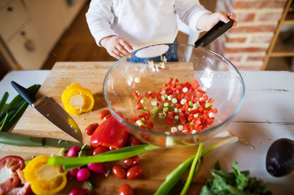 Toddler boy in the kitchen. - Stock Photo - Images