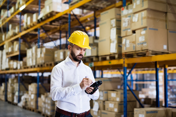 Warehouse worker or supervisor with barcode scanner. - Stock Photo - Images