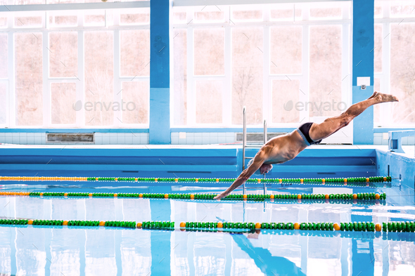 Senior man jumping in the swimming pool. - Stock Photo - Images