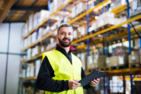Male warehouse worker with clipboard. - Stock Photo - Images