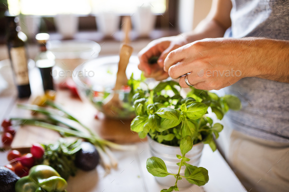 Unrecognizable young man cooking. - Stock Photo - Images