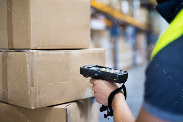 Male warehouse worker with barcode scanner. - Stock Photo - Images