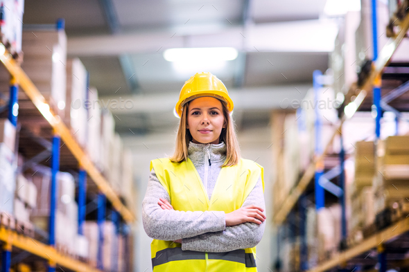 Portrait of a young woman warehouse worker. - Stock Photo - Images