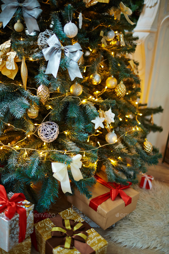 Decorated firtree and xmas gifts - Stock Photo - Images