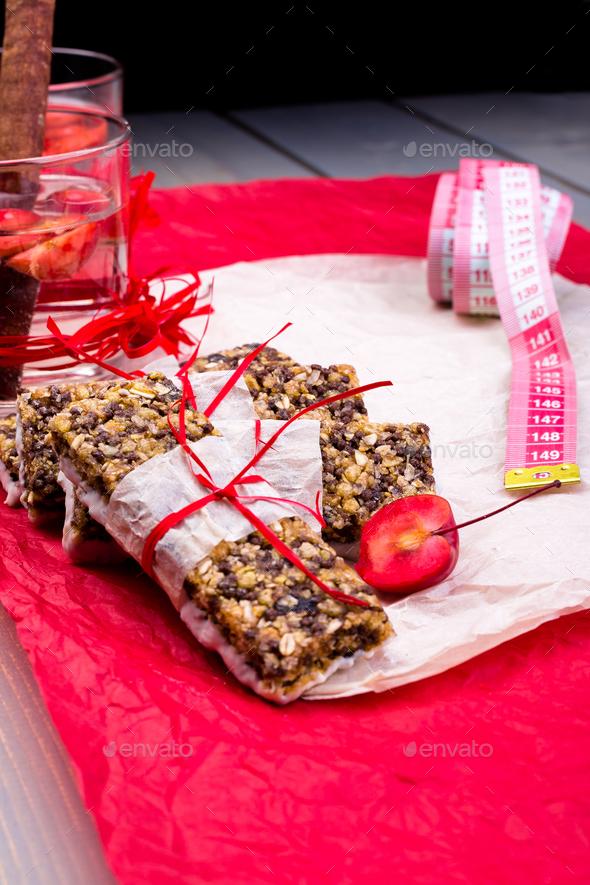 Diet muesli bars with detox apple cinnamon water - Stock Photo - Images