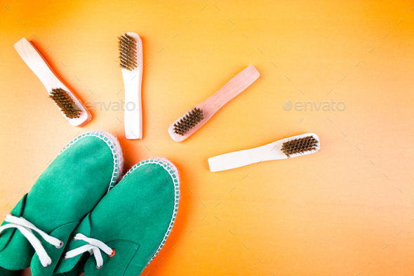Green suede espadrille shoes with brushes on yellow paper background. - Stock Photo - Images