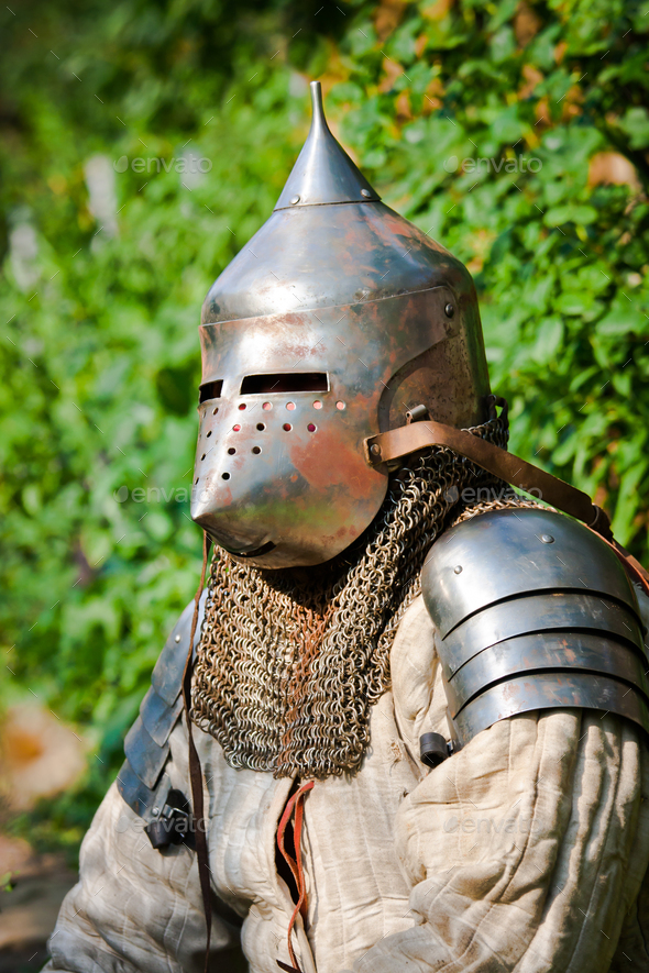 man in knight's helmet - Stock Photo - Images