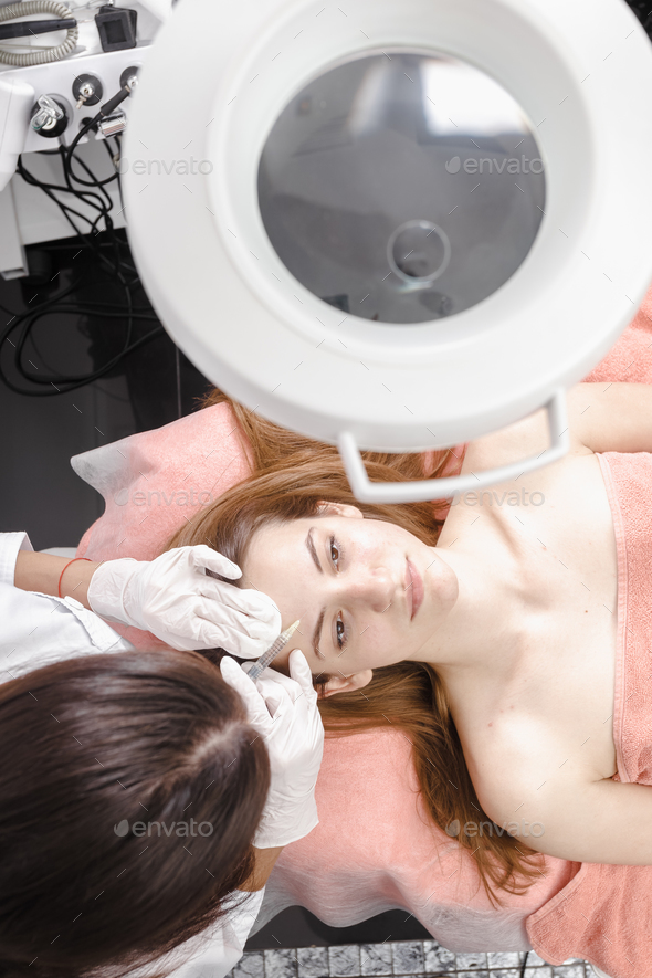 Young woman getting dermall fillers injection - Stock Photo - Images
