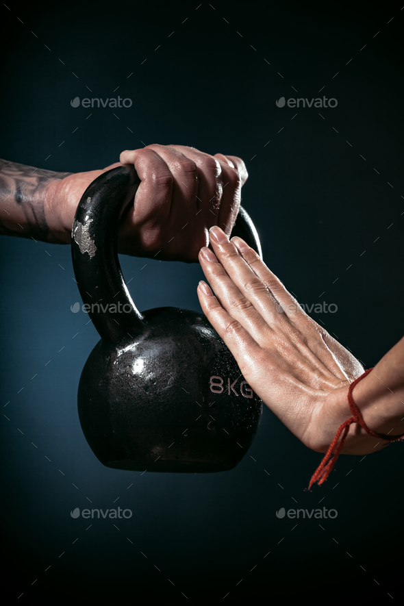 man offering dumbbell - Stock Photo - Images