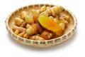 fresh whole turmeric on bamboo saucer - PhotoDune Item for Sale
