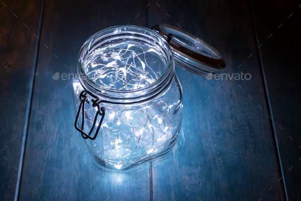 Glass jar filled with decorative lights - Stock Photo - Images