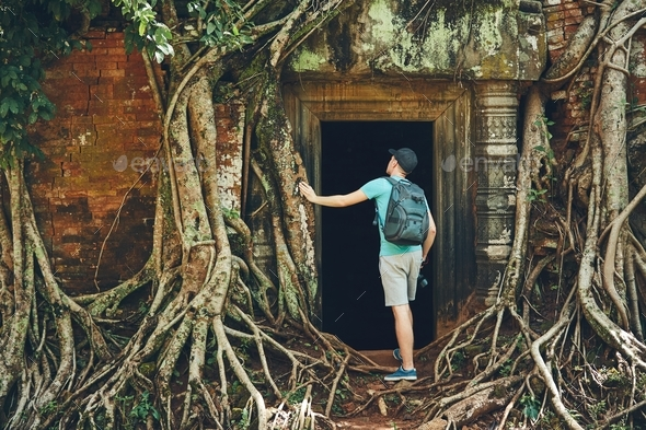 Traveler in the ancient temple - Stock Photo - Images