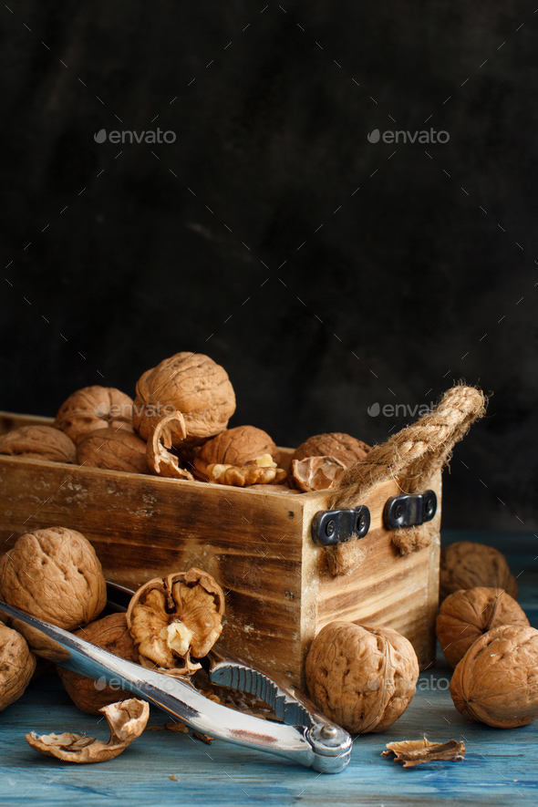 Fresh walnuts in a box on a blue wooden table - Stock Photo - Images