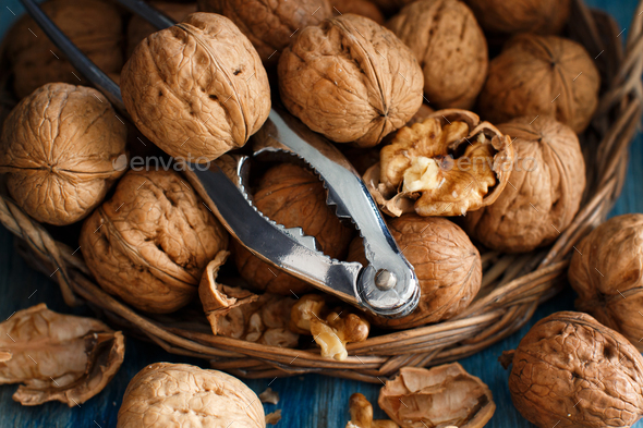 Fresh walnuts on a blue wooden table - Stock Photo - Images