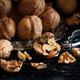 Fresh walnuts on a dark background - PhotoDune Item for Sale