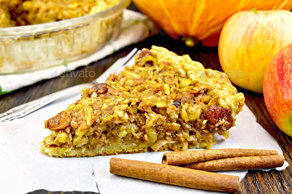 Pie with pumpkin and apples on parchment - Stock Photo - Images
