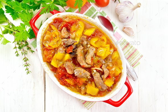Ragout of meat and vegetables in brazier on board top - Stock Photo - Images