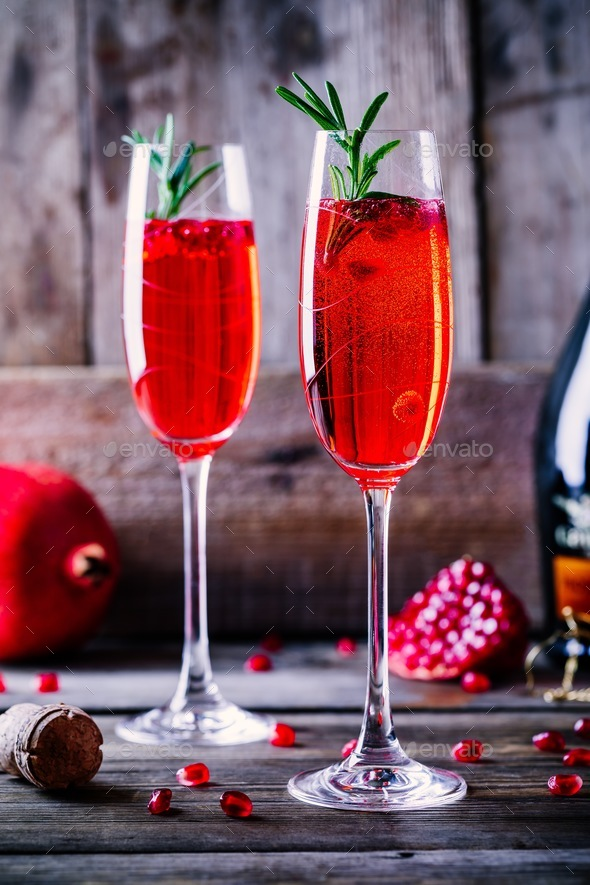 Pomegranate champagne mimosa cocktail with rosemary - Stock Photo - Images