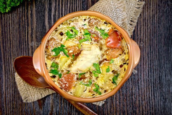 Soup fish with vegetables and cream on board top - Stock Photo - Images