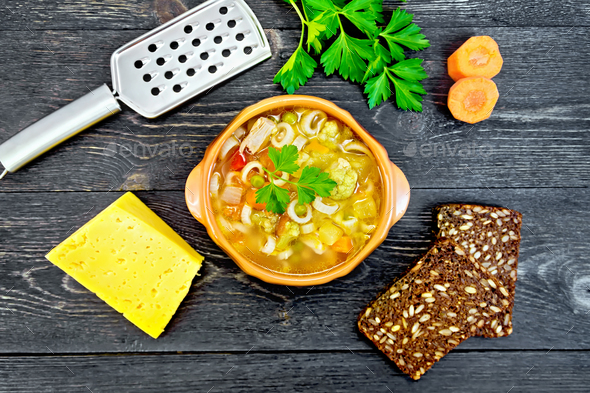 Soup Minestrone in clay bowl on black board top - Stock Photo - Images