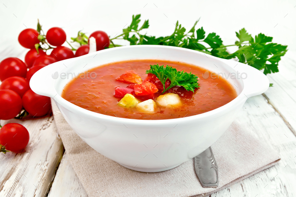 Soup tomato in white bowl with vegetables - Stock Photo - Images