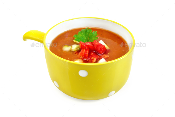 Soup tomato with parsley in yellow bowl - Stock Photo - Images