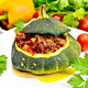 Squash green stuffed with meat and vegetables on dark board - PhotoDune Item for Sale