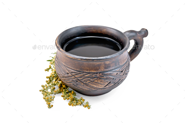 Tea with wormwood in clay cup - Stock Photo - Images