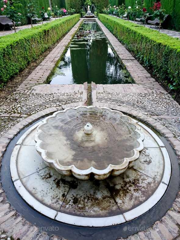 Fountain in the gardens of the Generalife Palace - Stock Photo - Images