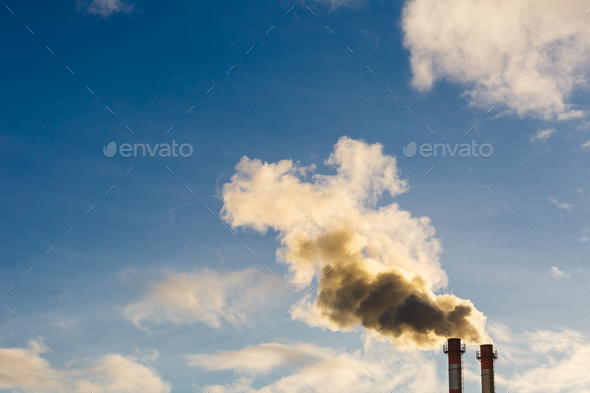 Stream of dark smoke from the chimney of factory - Stock Photo - Images