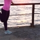 Young Fit Female Exercising Outdoors at Sunset - VideoHive Item for Sale