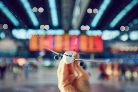 Hand is holding model airplan - Stock Photo - Images