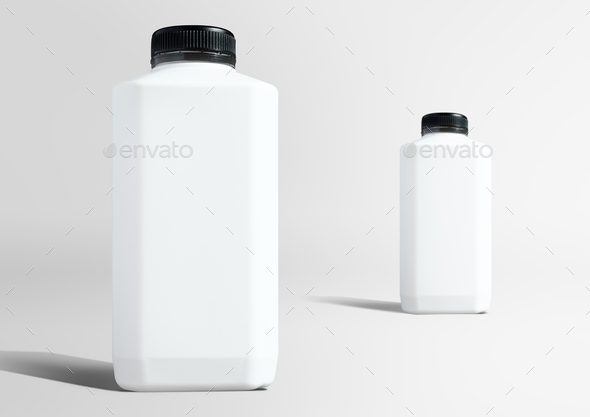 Blank white plastic bottles setting up in studio ready to use as - Stock Photo - Images