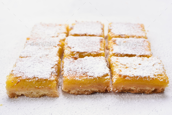 Lemon squares on baking paper - Stock Photo - Images