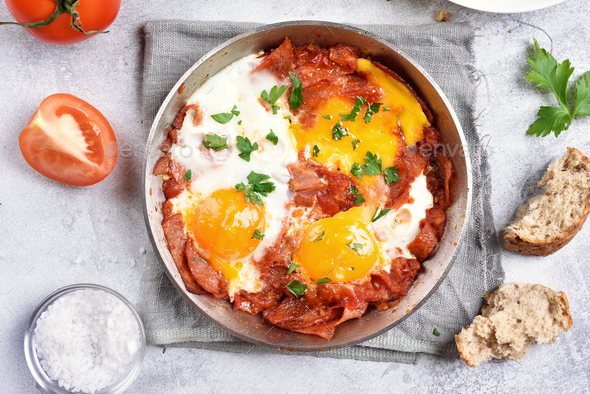 Fried eggs with tomatoes and bacon - Stock Photo - Images