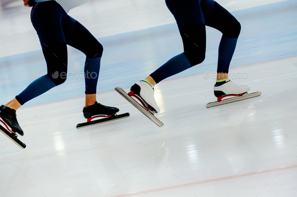 synchronous motion legs two athletes speed skaters - Stock Photo - Images