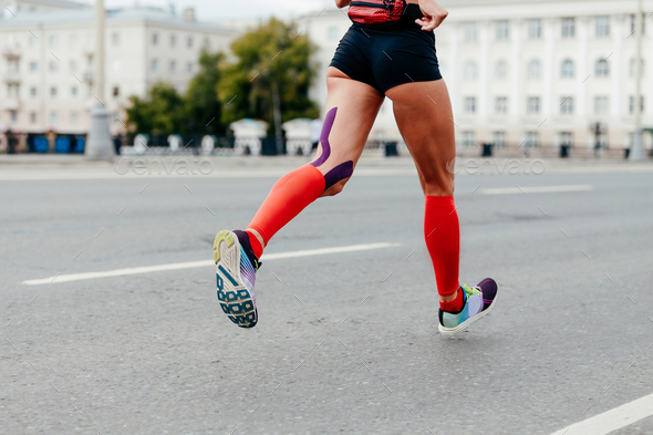woman running city marathon - Stock Photo - Images