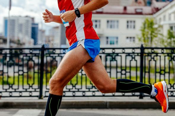 man running city marathon - Stock Photo - Images