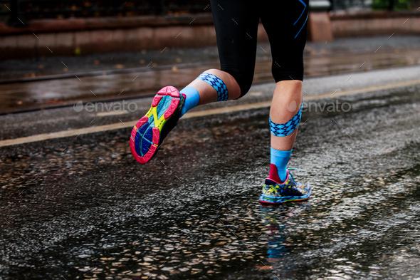 woman running urban marathon - Stock Photo - Images