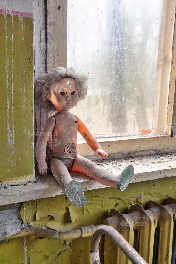 Radioactive doll in Chernobyl kindergarten - Stock Photo - Images