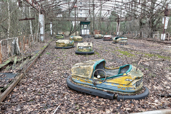 Attraction in amusement park in overgrown ghost city Pripyat. - Stock Photo - Images