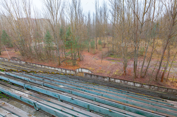 Overgrown stadium in ghost city Pripyat. - Stock Photo - Images