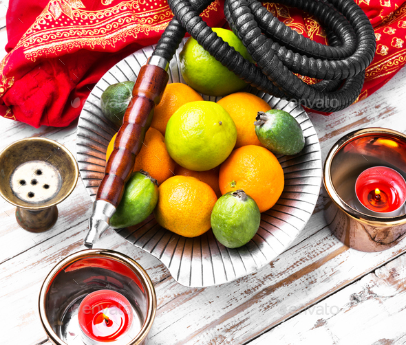 Shisha with taste of lime and tangerines - Stock Photo - Images