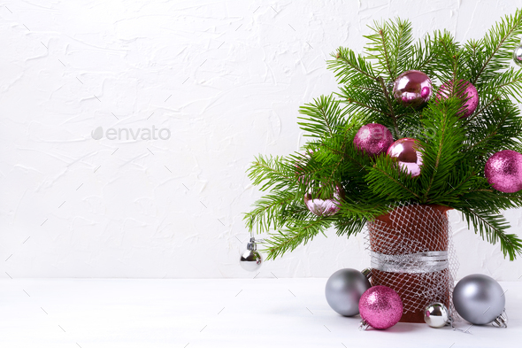 Christmas centerpiece with pink and silver baubles, copy space - Stock Photo - Images