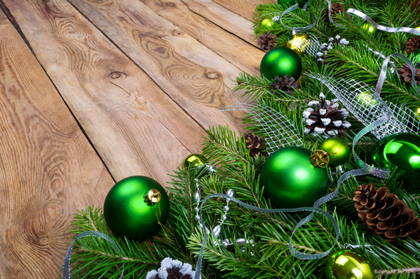 Christmas garland with green baubles on the rustic wooden backgr - Stock Photo - Images