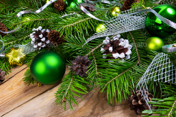 Christmas holiday greeting background with green ornaments - Stock Photo - Images